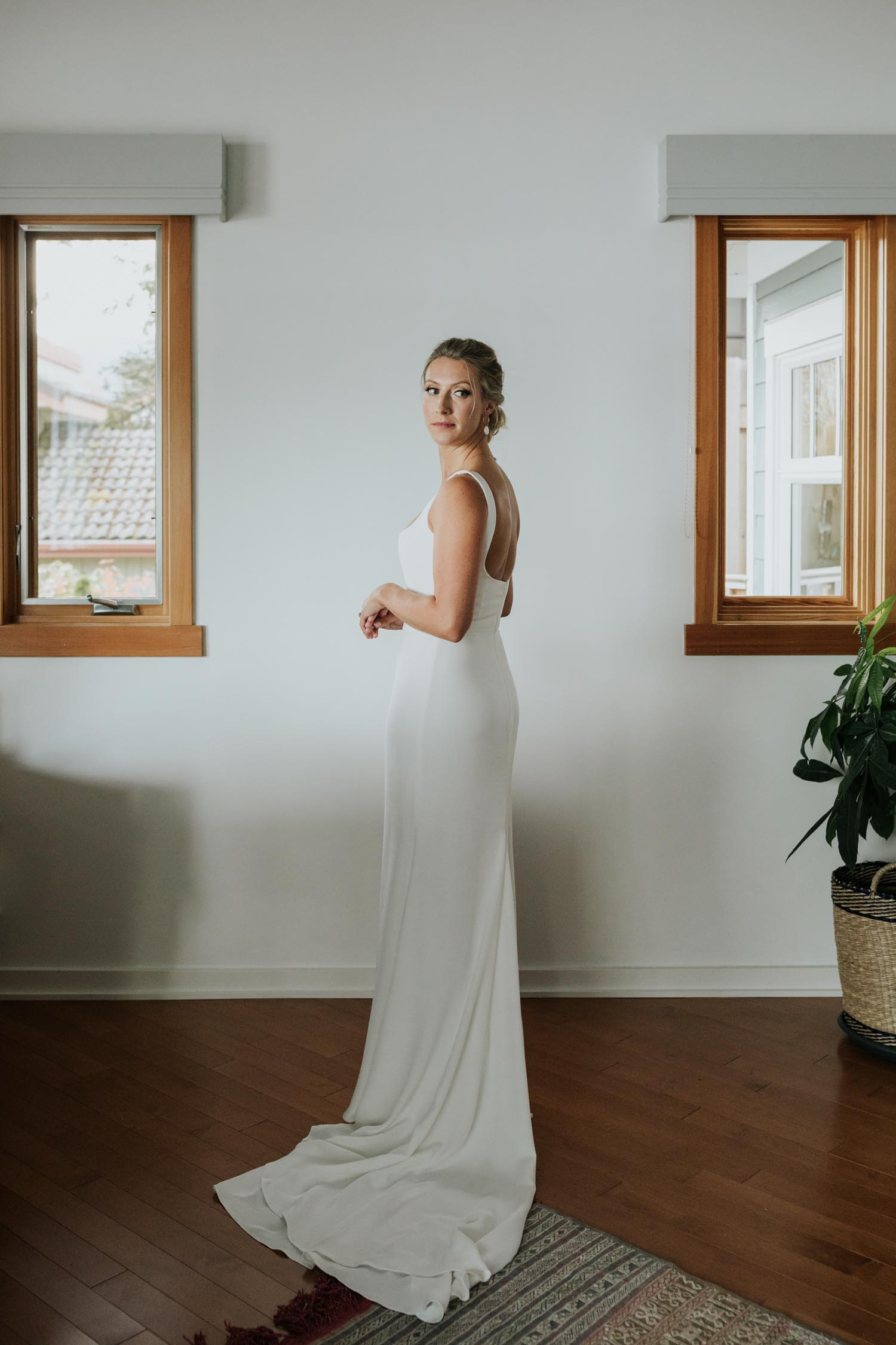 Beautiful blonde natural bride wears modern white Rime Arodaky wedding dress