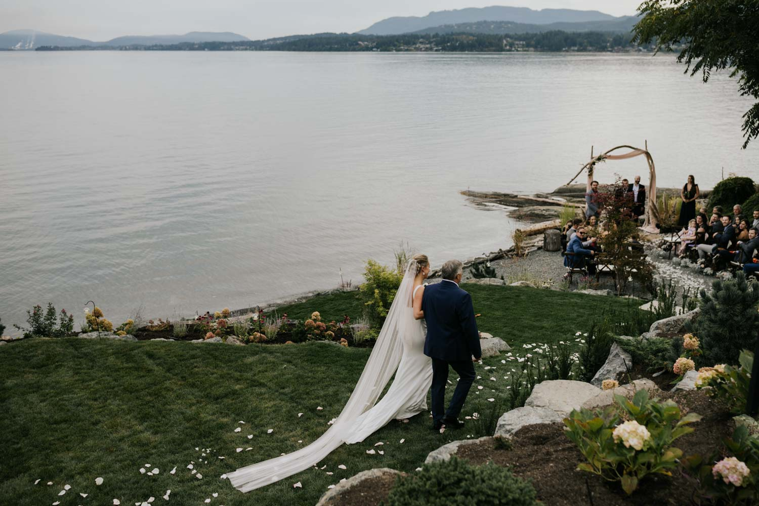 Epic photo of bride walking down the aisle with her dad at intimate Vancouver Island beach wedding