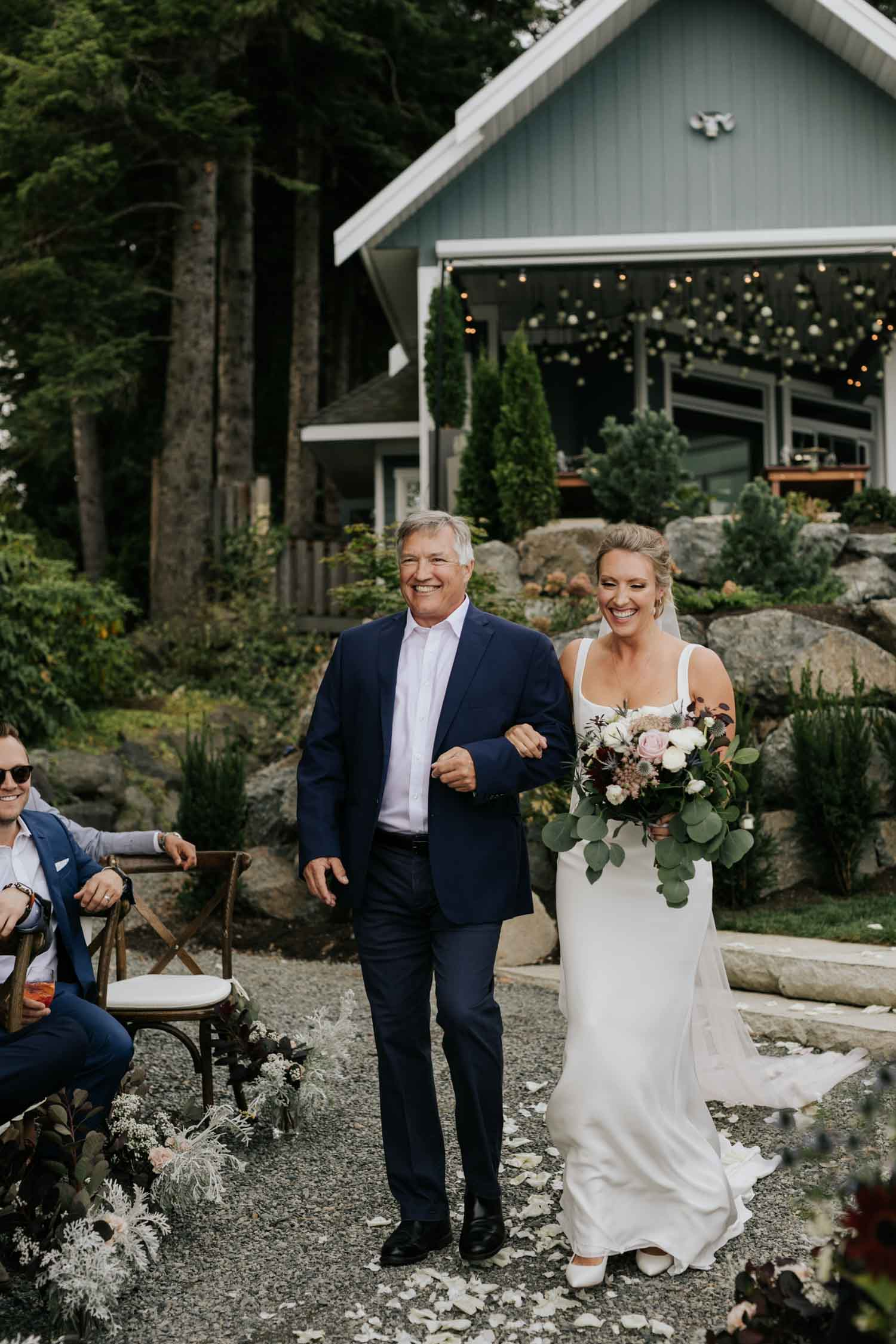 Emotional photo of bride walking down the aisle with her dad at intimate Vancouver Island beach wedding