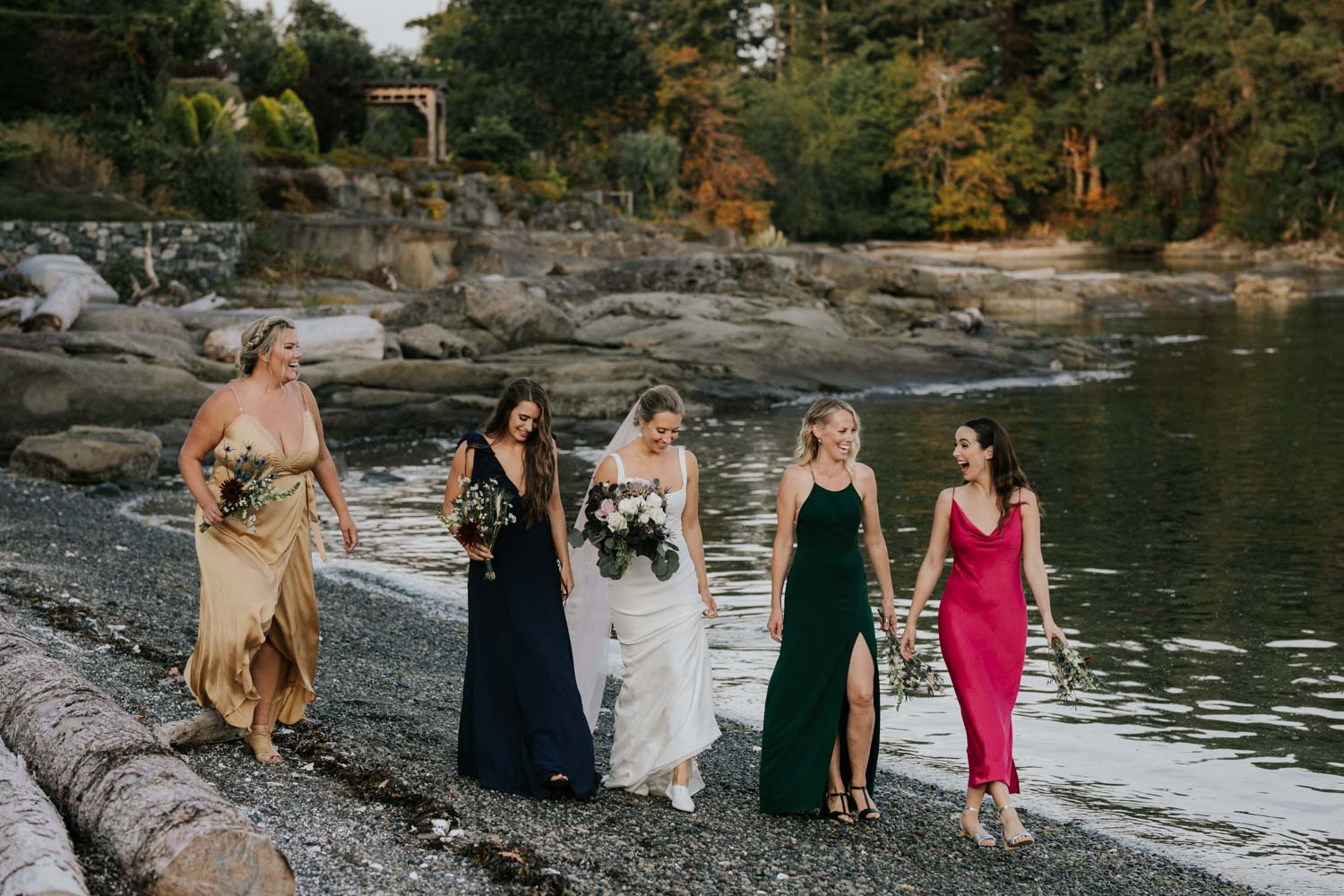 Mismatched royal coloured bridesmaid silk dresses at beach wedding on Vancouver Island