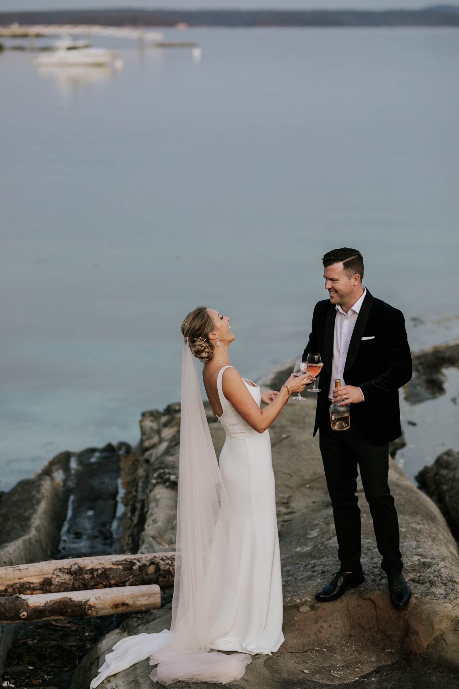 Natural and fun Vancouver Island Wedding Photographer captures intimate beach wedding on Vancouver Island at beautiful venue and location with sea and mountain views
