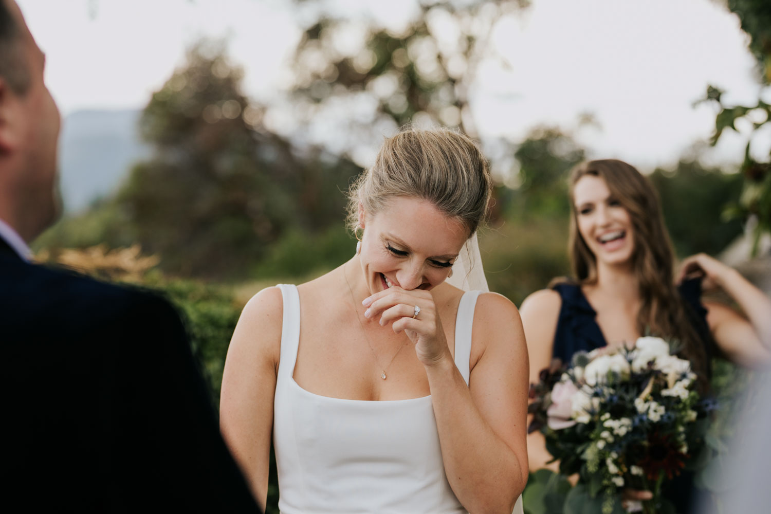 Elated bride laughs during wedding ceremony