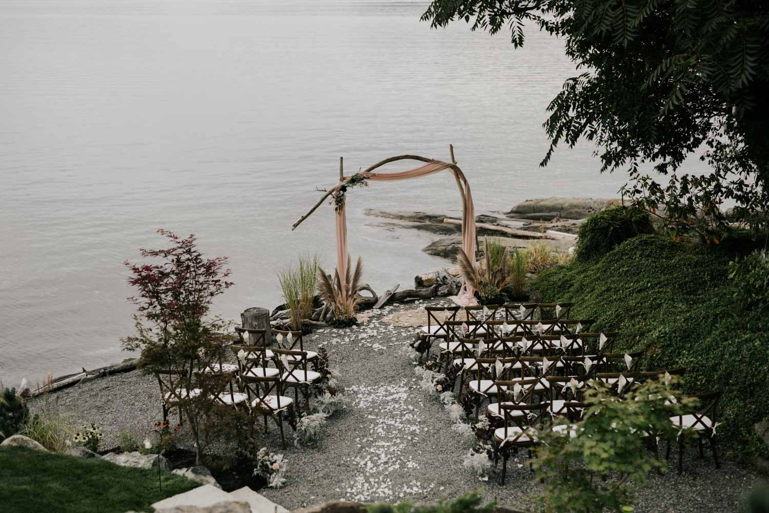 Beautiful ceremony setup for small wedding on the beach overlooking the sea on Vancouver Island decor ideas simple wooden flower arch boho mat