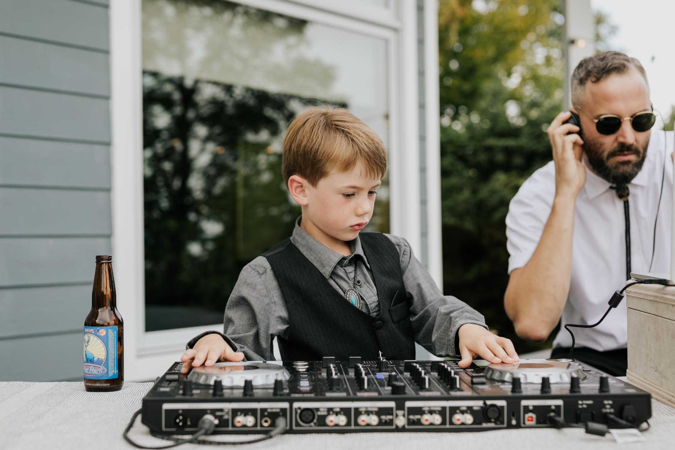 Page boy pretends to be DJ at wedding