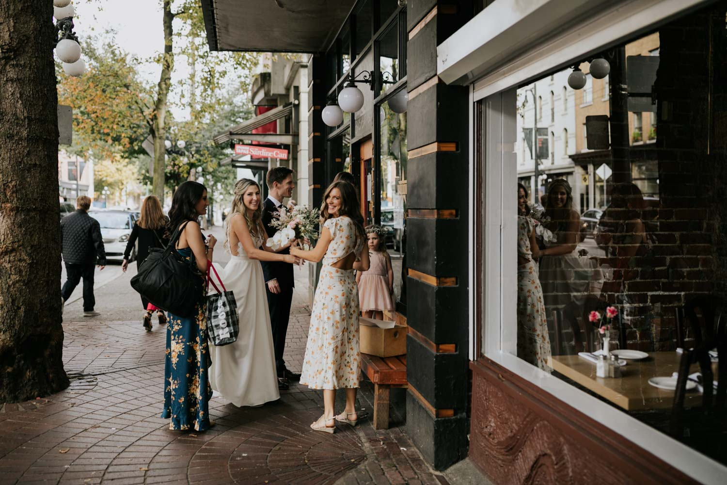 Bride and bridesmaids on the streets of Gastown, outside The Diamond