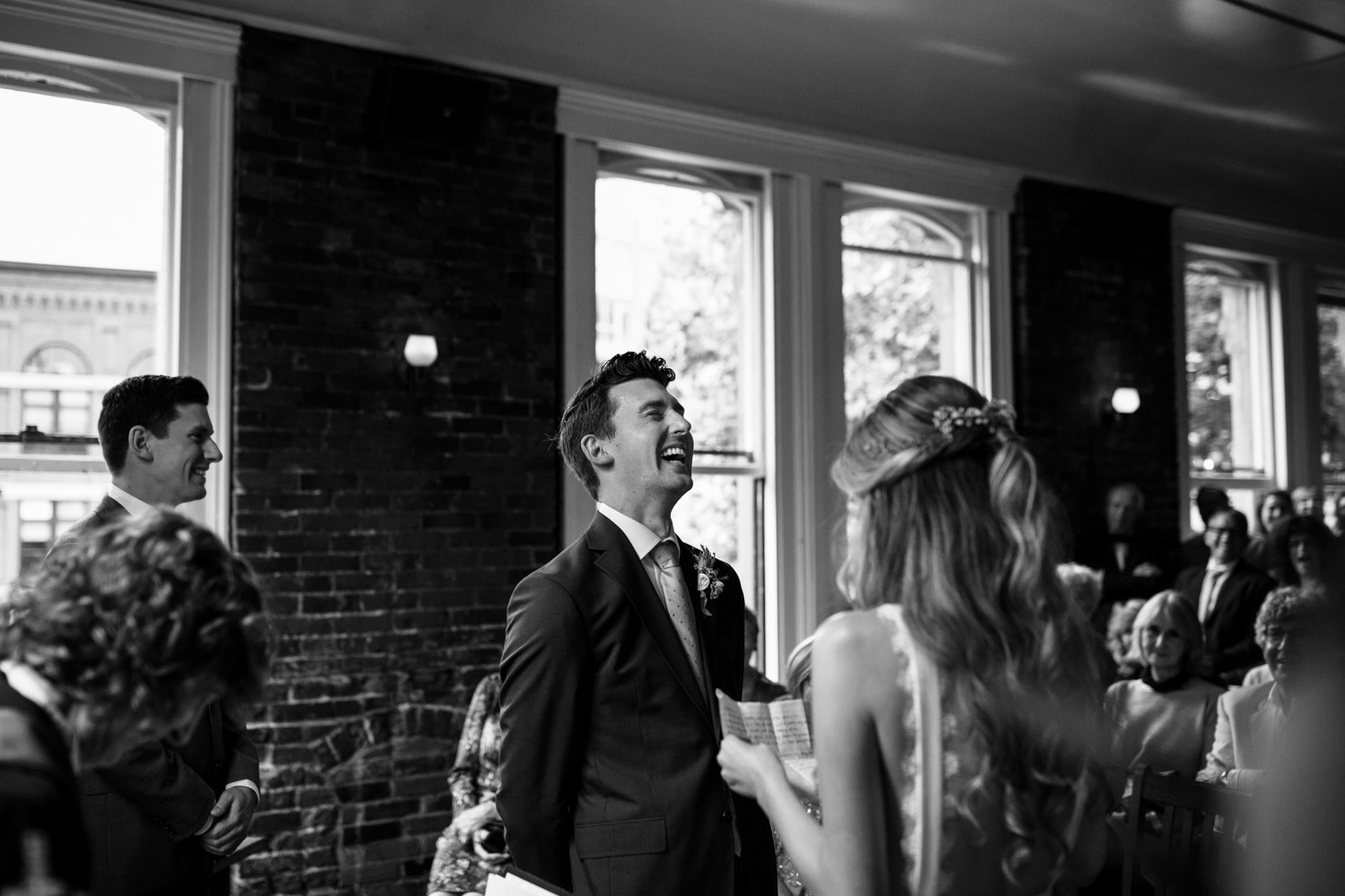 Groom laughs with joy as bride says her vows at Vancouver wedding