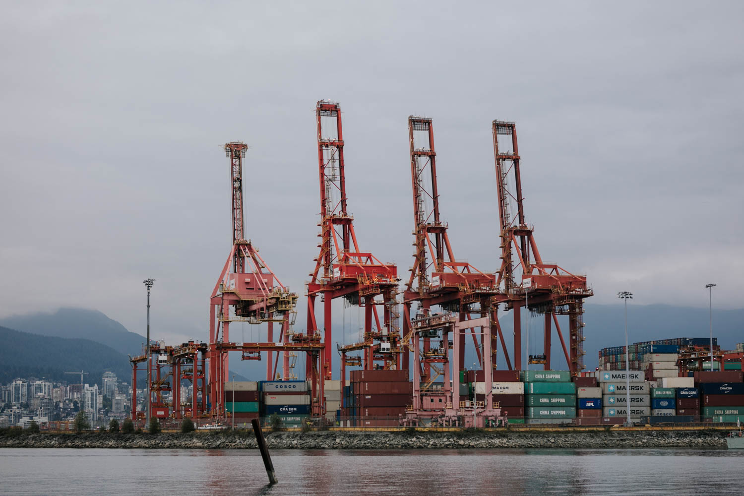 View of mountains and shipping yard from Crab Park in Vancouver