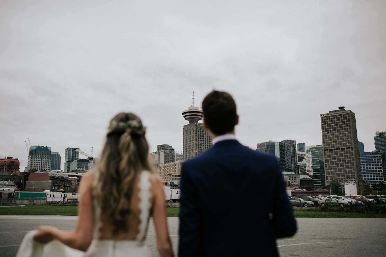 Wedding photo session taken at Crab Park in Vancouver with city skyline in the background