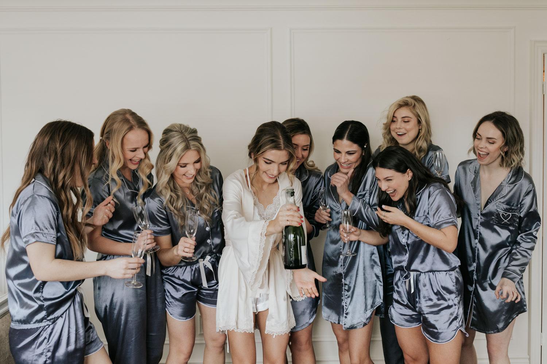 Bridesmaids champagne pop