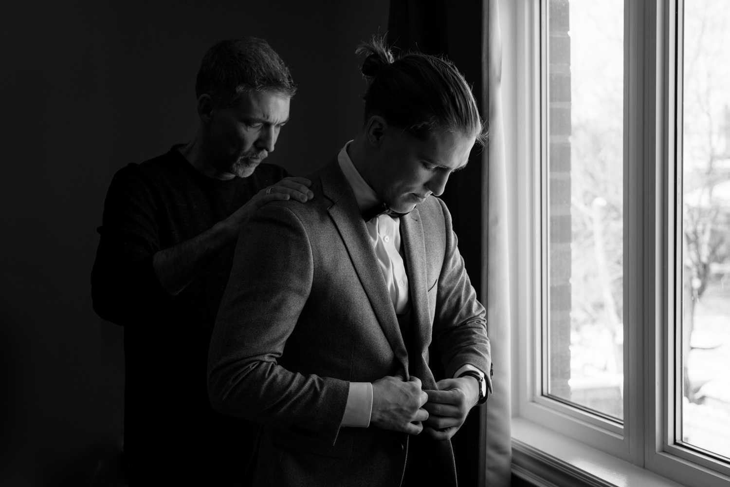 Candid groom getting ready images