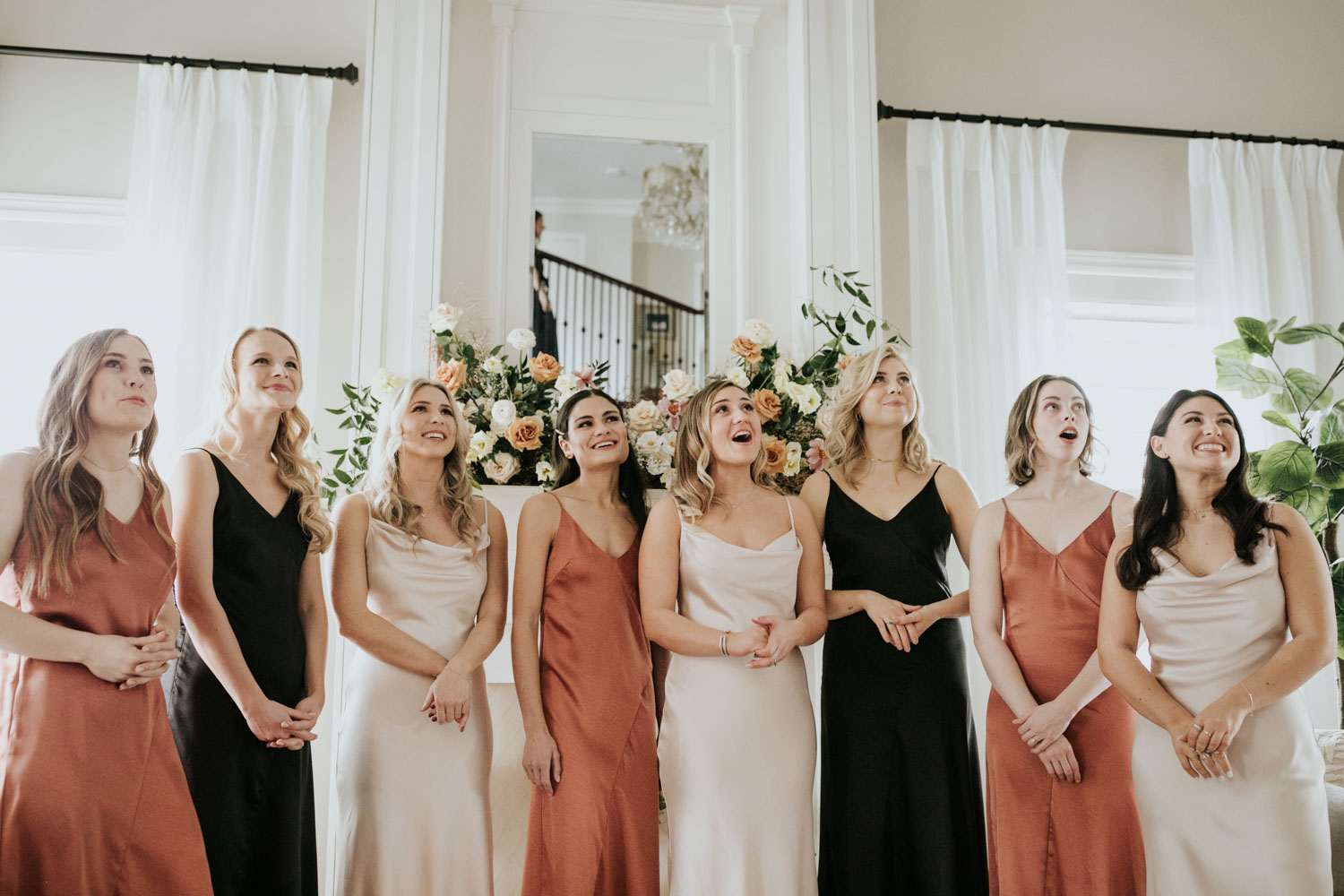 Emotional First Look with Bridesmaids and Bride